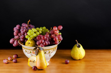 still life of ripe grapes and pears