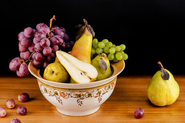 beautiful still life of ripe grapes and pears