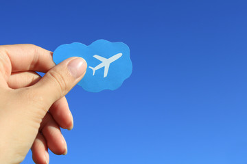 Airplane picture in the hand with blue sky background
