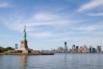 Statue of Liberty, and Manhattan Skyline behind it