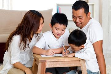Asian kids writing