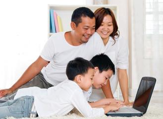 asian preschool children using laptop