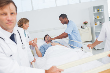 Doctors give oxygen to the patient