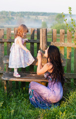 mother and little girl in garden