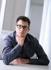 man with eyeglasses i office