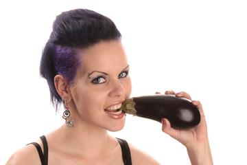 Woman biting into eggplant