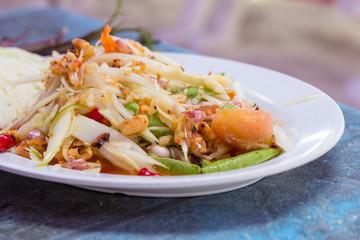 Papaya salad on table of thai food
