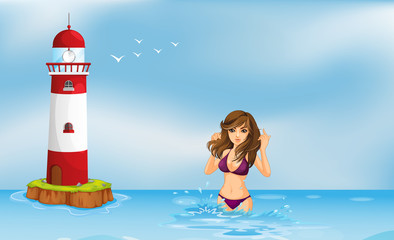 A girl wearing a bikini at the beach beside a tower