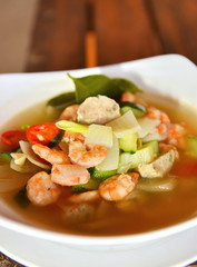 Tom Yum Goong soup served in white bowl