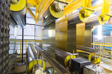 Rolls of aluminum extend on special machines of rolling mill