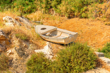 Abandoned fishing boat landmark in greek islands Syros in cyclad