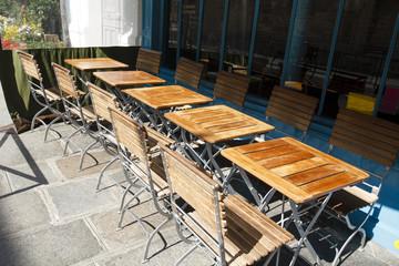Sunlit restaurant tables, Paris, France