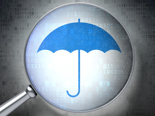 Security concept:  Umbrella with optical glass on digital backgr