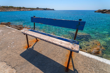 Fototapete - Rest place by wood in greek island syros with sea in background
