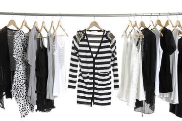 stripy shirt and Fashion female clothing hanging on hangers