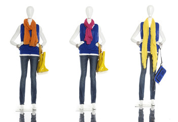 female clothing in jeans with bag, scarf, on mannequin