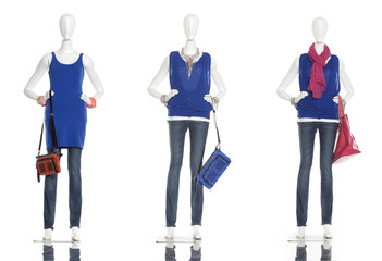 female clothing in jeans with bag on three mannequin