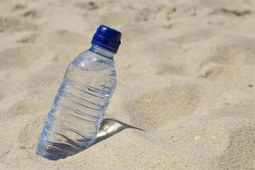 Bottle of water on the sand