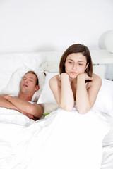Snoring man, distraught woman