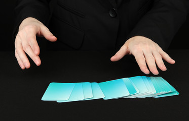 Hand with business cards. Concept: Business like poker game.