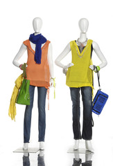 female clothing in jeans with scarf, bag on two mannequin