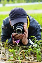 Man photographs a flower