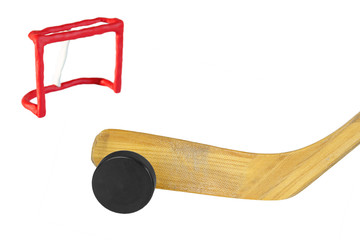 Hockey stick, puck and goal
