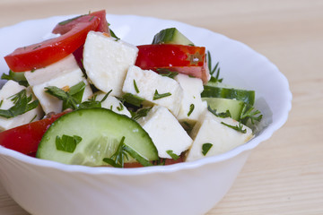 low-calorie salad with fresh vegetables and cheese