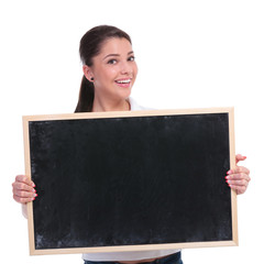 casual woman holds blackboard