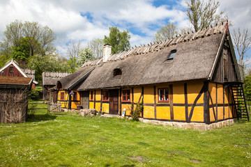 Old yellow cottage.  Very old cottage in sweden, grass on the ro