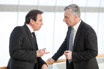 Mature executive discussing with associate