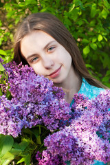 Beautiful girl with lilac flowers