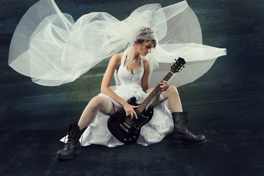 Bride playing rock guitar, wedding funny music