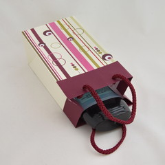 Gift paper packaging with cord on white background