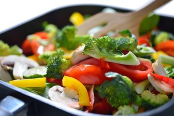 stir fried vegetables in a pan