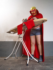 Mexican wrestler ironing his tights