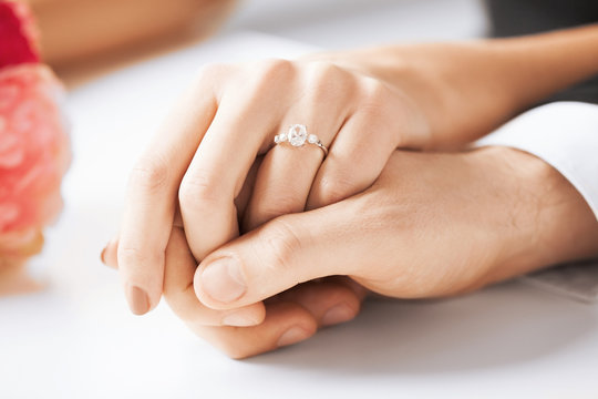 man and woman with wedding ring