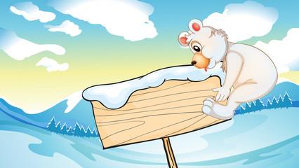 A bear beside the empty wooden signboard