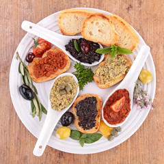 assortment of tapenade and bread