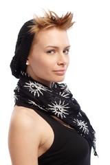 Trendy woman smiling in cap and scarf