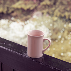 Cup in rainy day