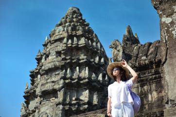 Girl in bayon temple cambodia
