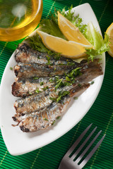 Grilled sardine fish with lemon and lettuce