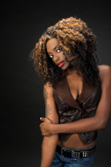 Beautiful African American woman with gorgeous lips wearing jean