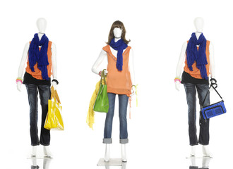 Three female clothes in jeans with bag ,scarf on a mannequin