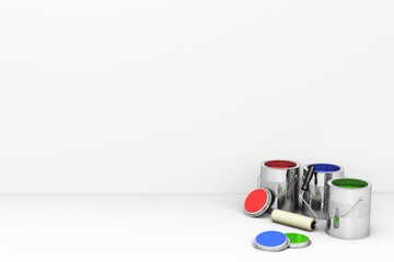 Cans with a palette of colors and a roller brush near the wall