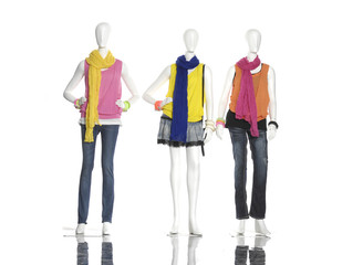 female dress with colorful scarf on three mannequin