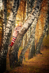 happy girl in autumn forest