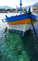 Yellow Fishing boat on crystalline sea