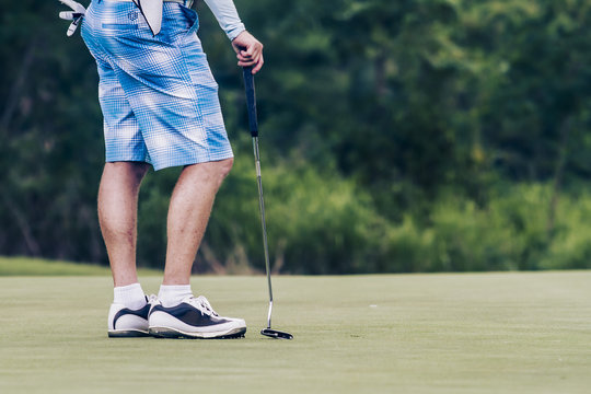 Golfer waiting on green at St Andrews golf course Thailand